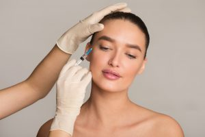 Woman with perfect skin receiving botox injection